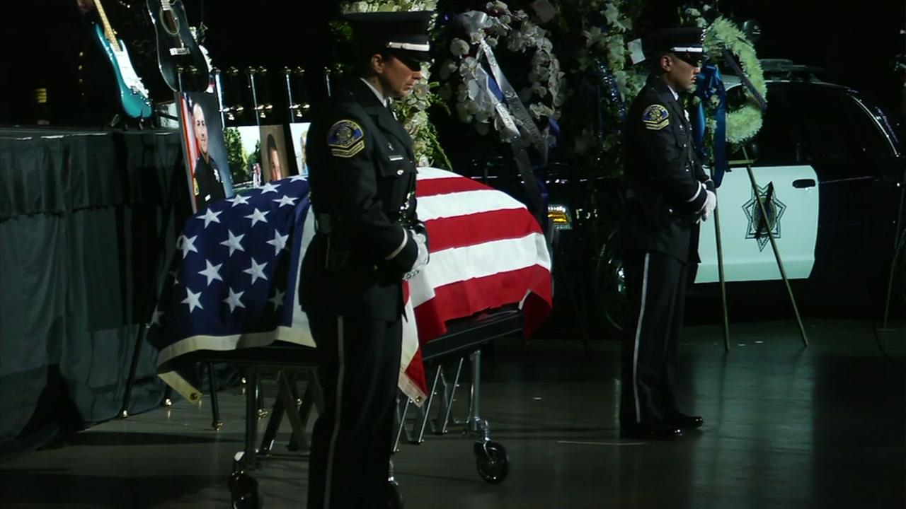Officers stand in front of SJPD Officer Michael Kathermans casket at his public memorial service at SAP Center in San Jose, Calif. on Tuesday, June 21, 2016.KGO-TV