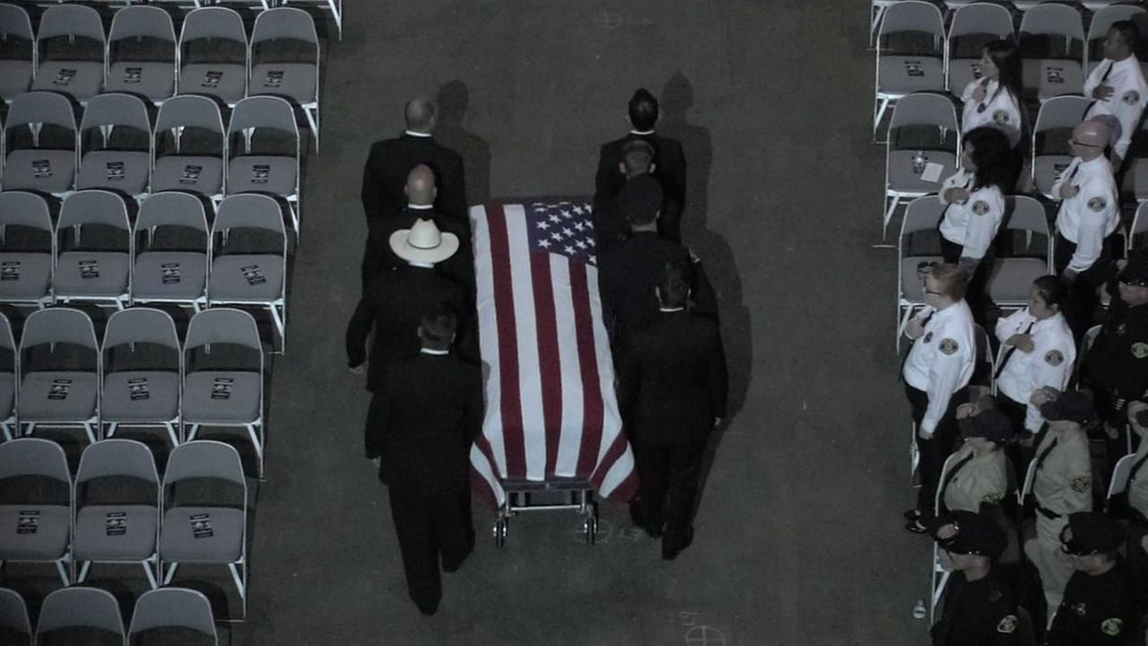 Fallen SJPD Officer Michael Katherman's casket is carried out of the SAP Center in San Jose, Calif. following his memorial service on Tuesday, June 21, 2016.KGO-TV
