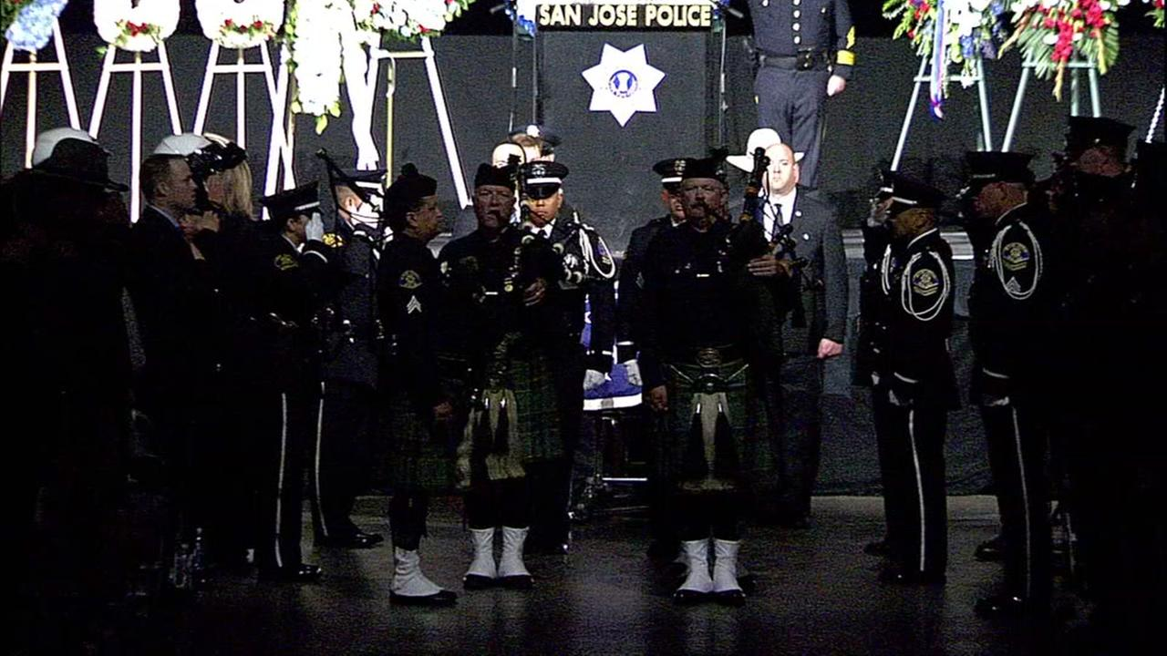 Bagpipes are played at the SAP Center in San Jose, Calif. following fallen SJPD Officer Michael Kathermans memorial service on Tuesday, June 21, 2016.KGO-TV