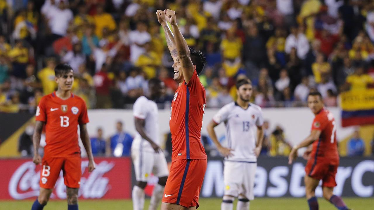 Chile goalkeeper Claudio Bravo (1), right celebrates with and Chiles Mauricio Isla (4) and other players during a Copa America Centenario semifinal soccer match at Soldier Field.