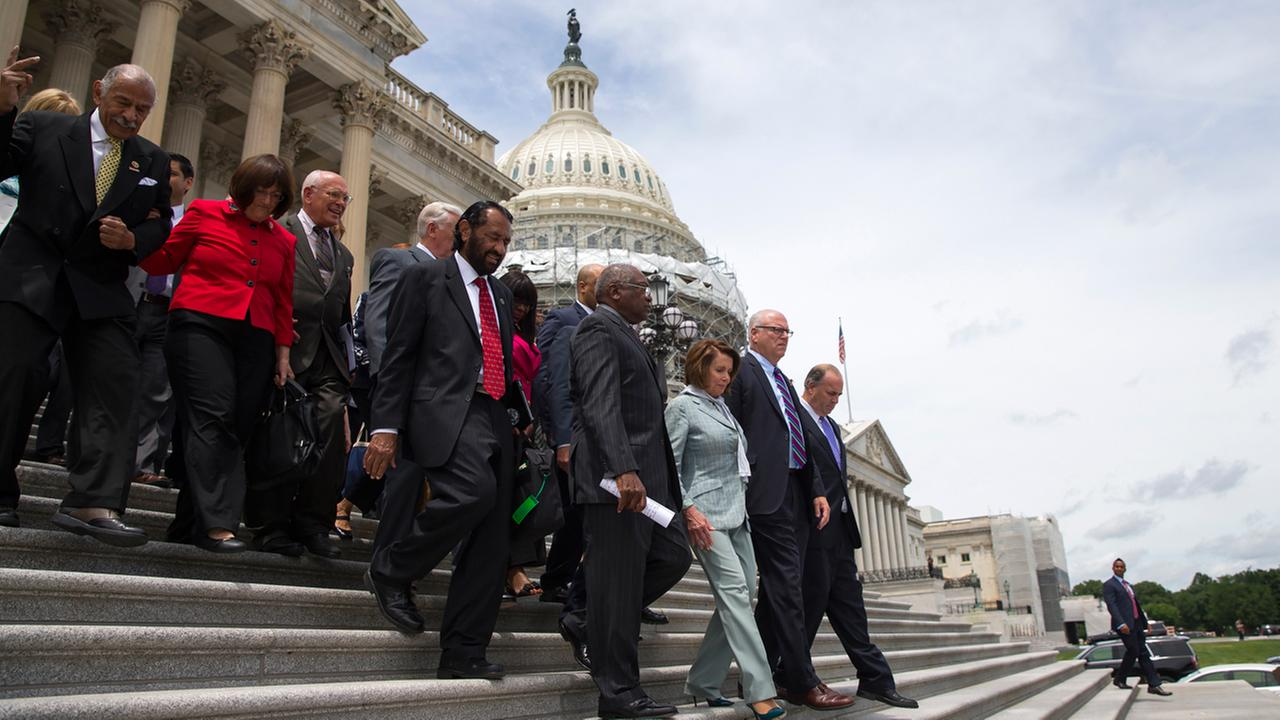 House Democrats walk down the steps of the Capitol building in Washington, Thursday, June 23, 2016.