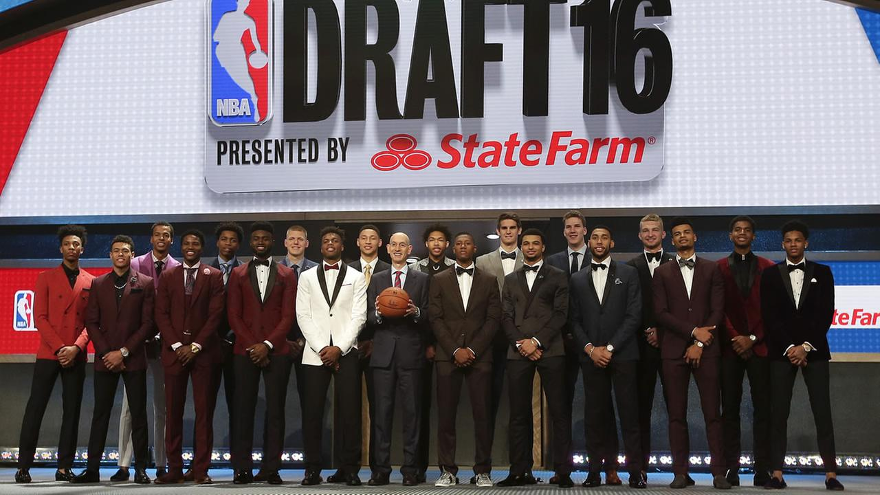 Prospective NBA draft picks pose for a group photo with NBA Commissioner Adam Silver, center, before the start of the NBA basketball draft, Thursday, June 23, 2016, in New York.