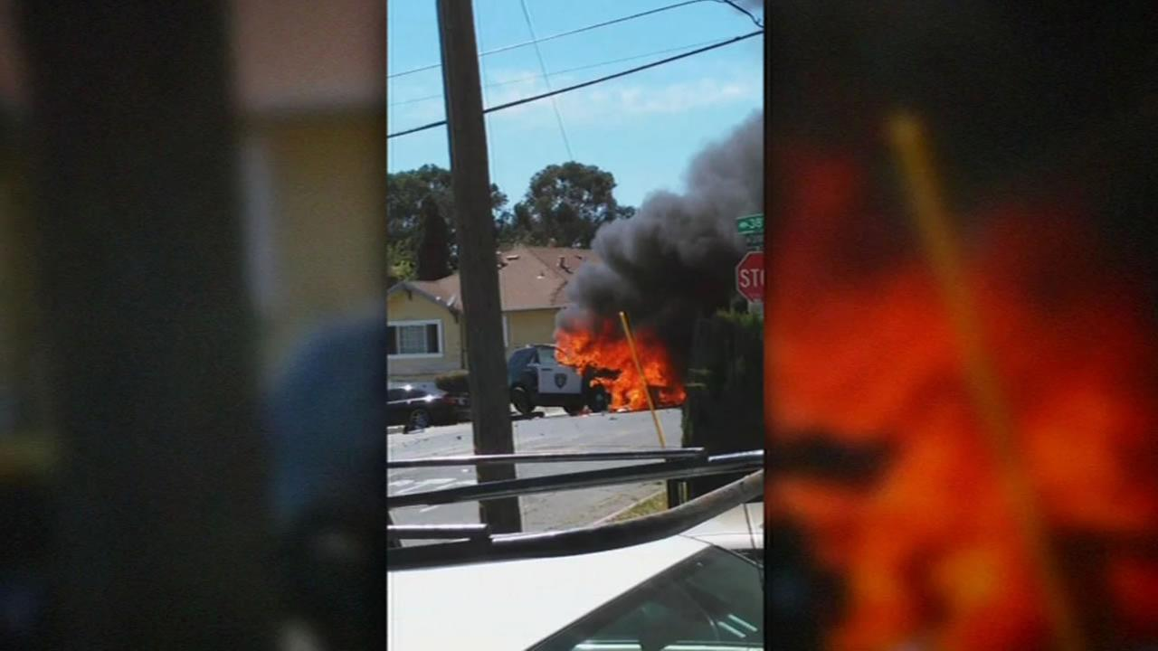 Cellphone video shows an Oakland Police Department SUV on fire following a crash at 38th Avenue and Carrington Street in Oakland, Calif. on Sunday, June 26, 2016.