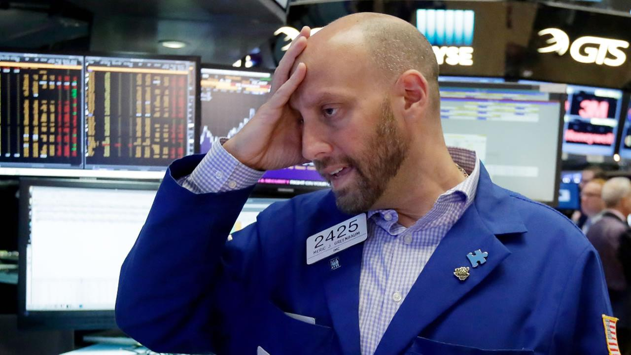 Specialist Meric Greenbaum works at his post on the floor of the New York Stock Exchange, Friday, June 24, 2016.