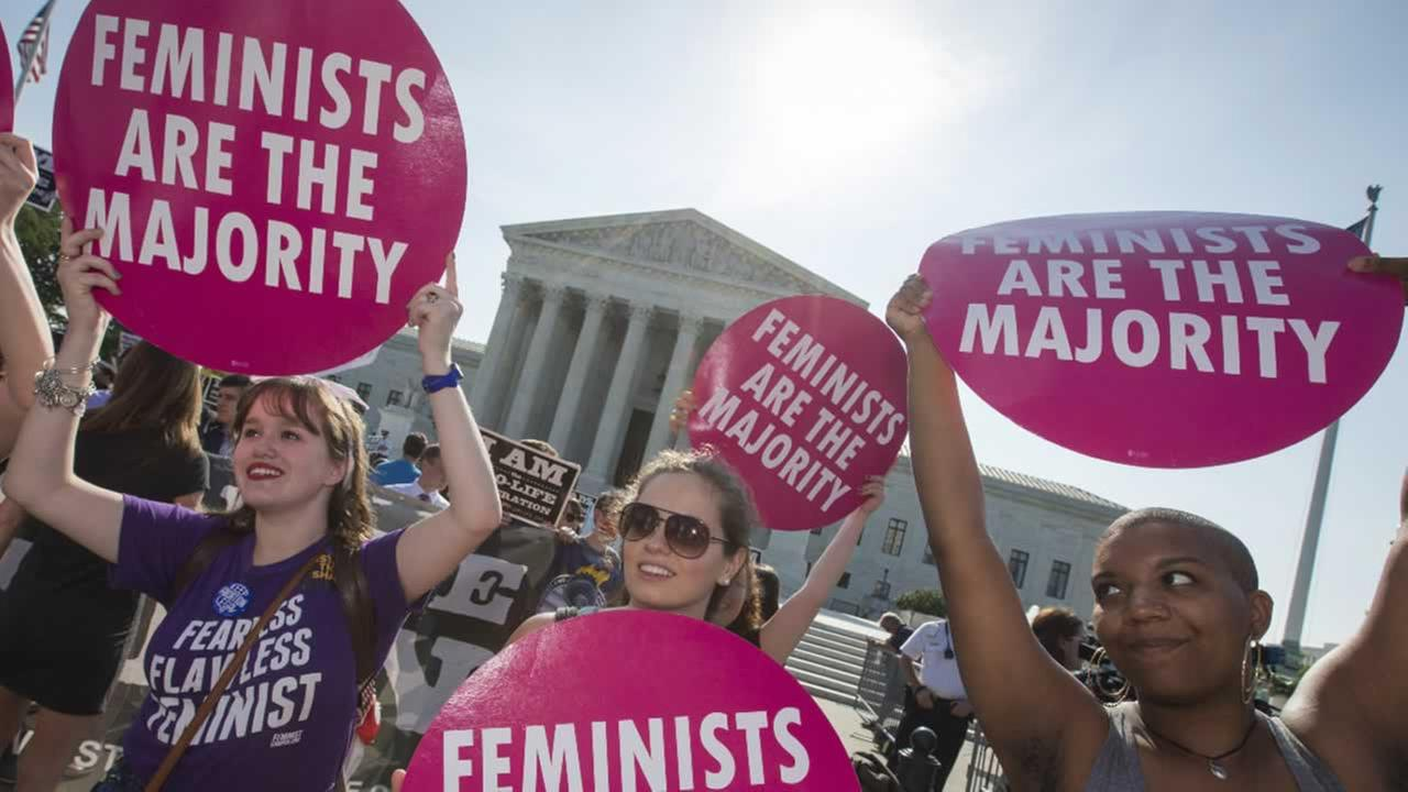 Activists demonstrate in front of the Supreme Court in Washington, June 27, 2016.