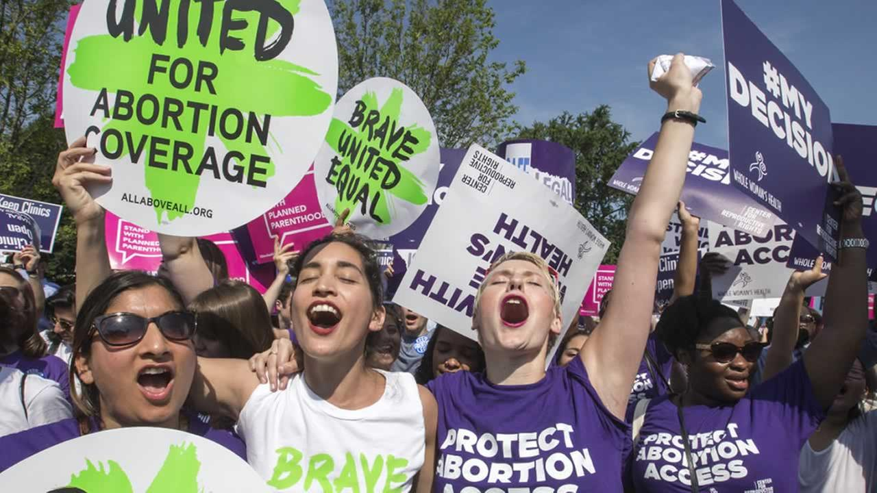 Abortion rights activists rejoice in front of the Supreme Court in Washington, Monday, June 27, 2016, as the justices struck down the strict Texas anti-abortion restriction law.
