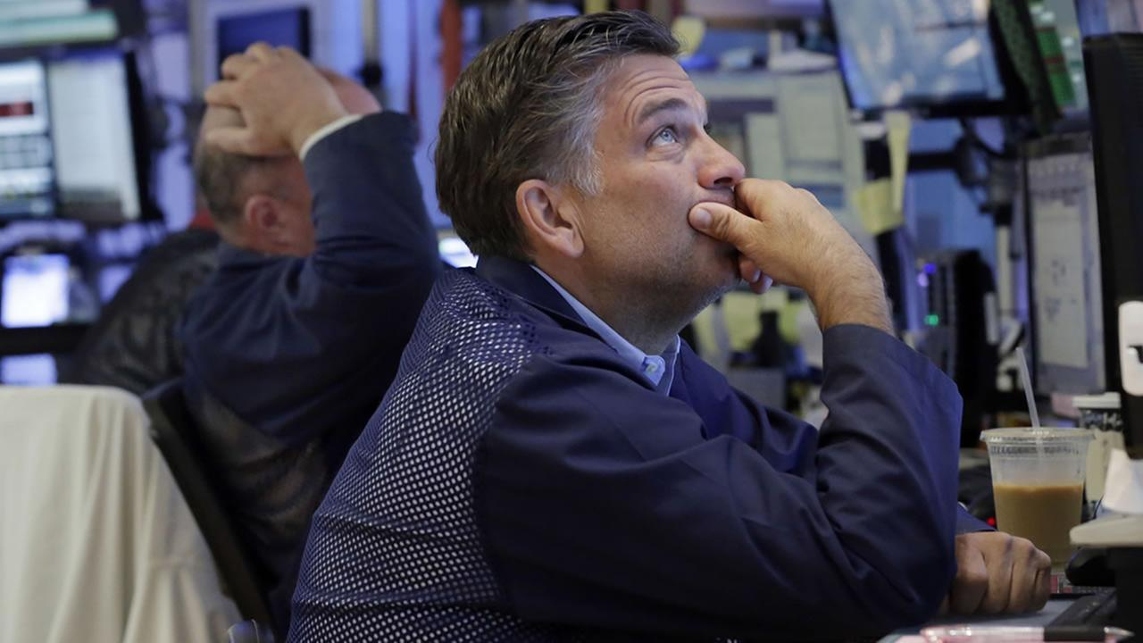 Trader Jeffrey Lucchesi works on the floor of the New York Stock Exchange, Monday, June 27, 2016. (AP Photo/Richard Drew)
