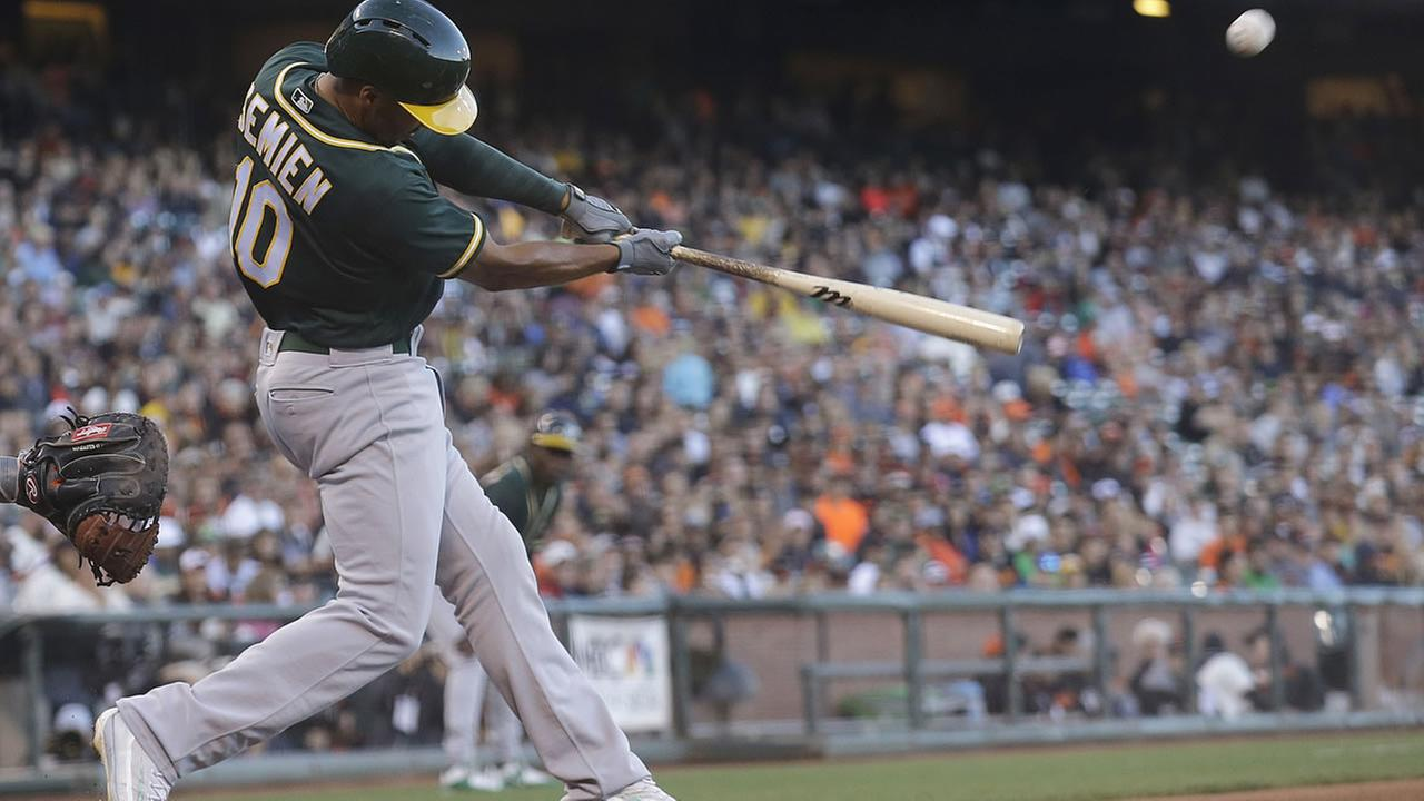 Athletics Marcus Semien hits a three-run home run off of Giants Jeff Samardzija during a baseball game in San Francisco, Monday, June 27, 2016. (AP Photo/Jeff Chiu)