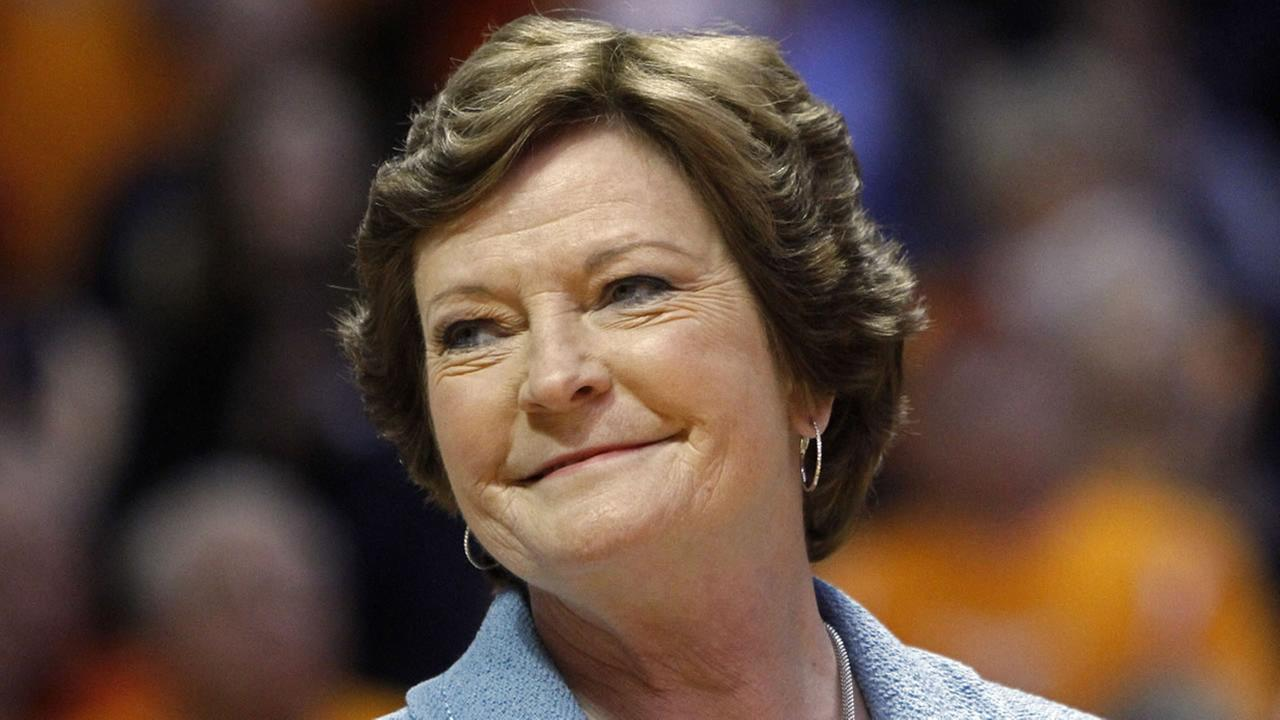 In this Jan. 28, 2013, file photo, former Tennessee womens basketball coach Pat Summitt smiles as a banner is raised in her honor.