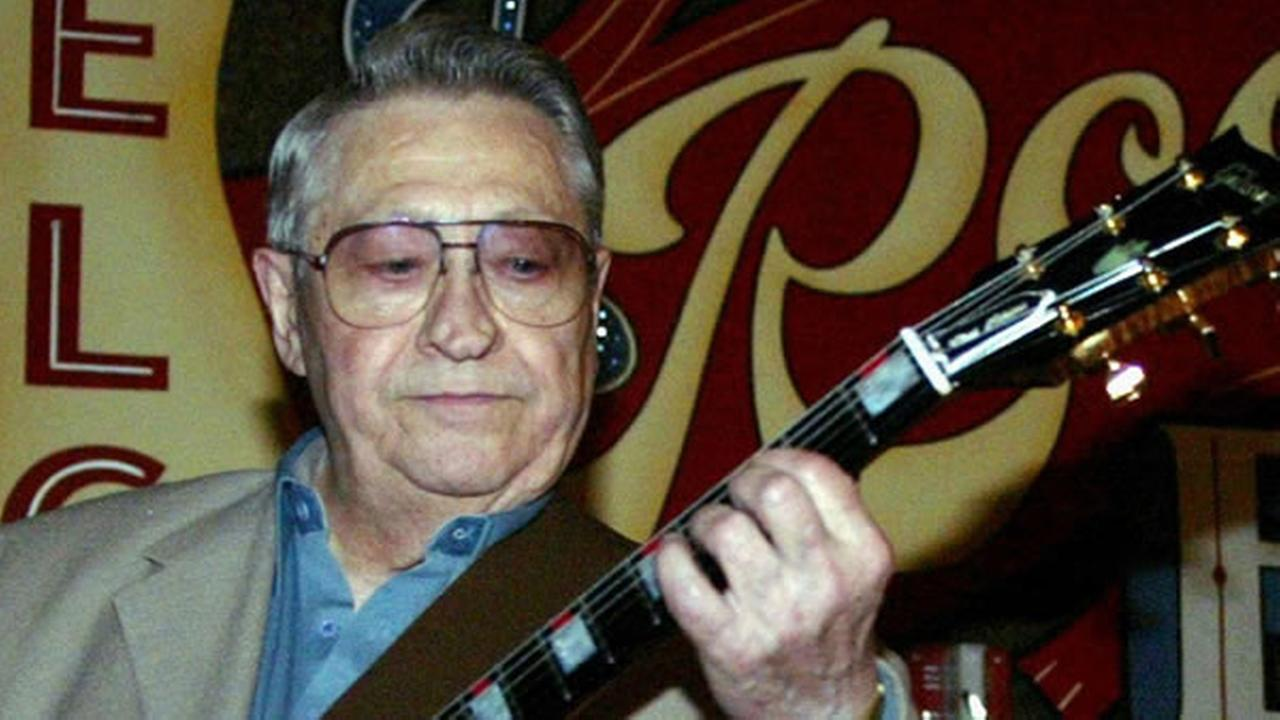 This April 30, 2003, file photo shows Scotty Moore, a former guitarist for Elvis Presley, playing music at the 2nd annual Ponderosa Stomp in New Orleans.