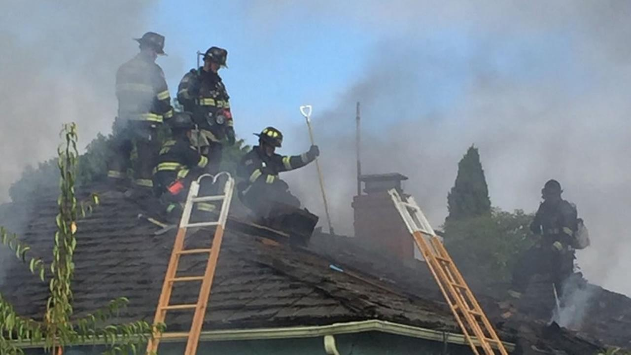 This image shows firefighters battling a house fire in Hayward, Calif. on June 29, 2016.