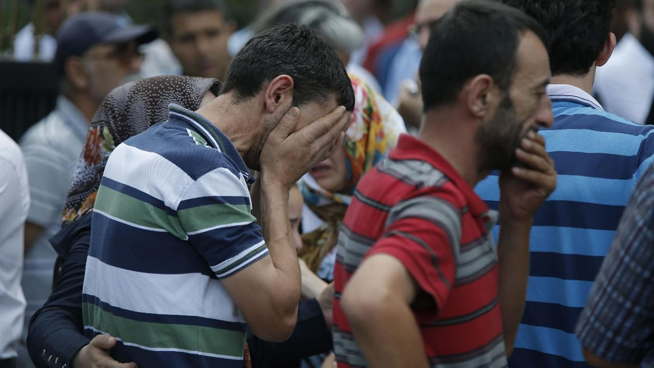 Family members of victims cry outside the Forensic Medical Center in Istanbul, Wednesday, June 29, 2016.