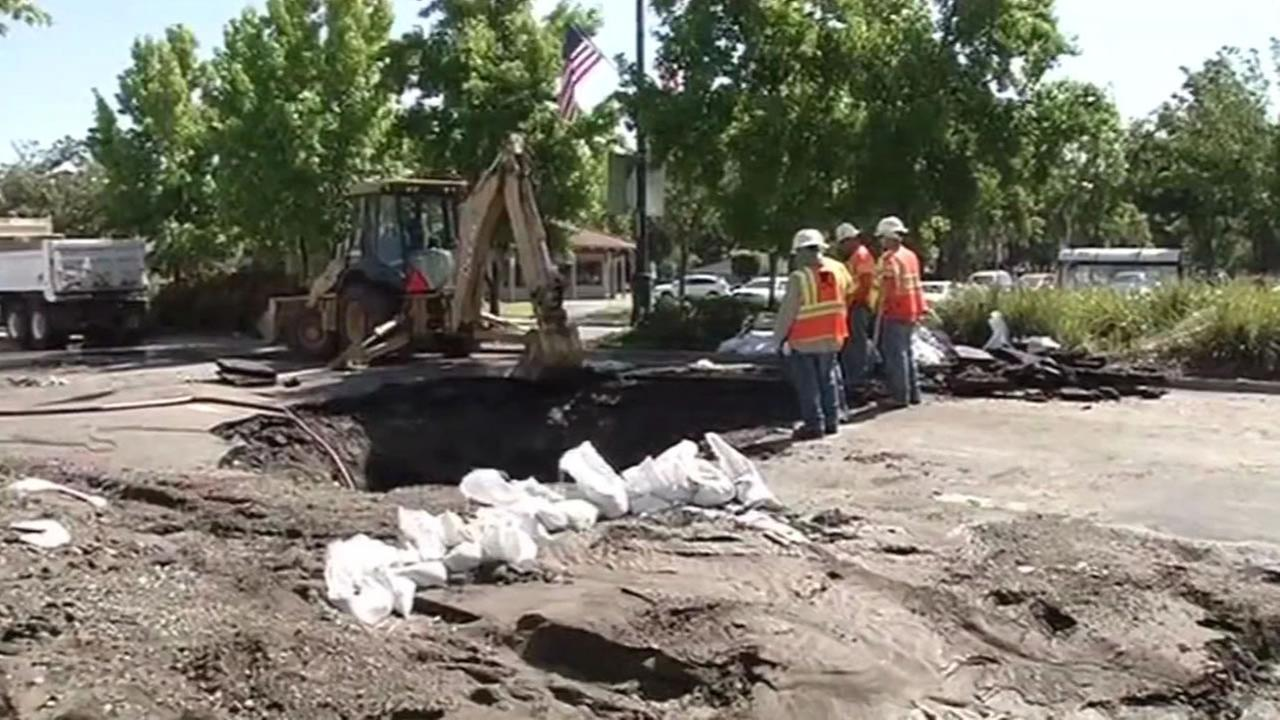 This image shows crews working to repair a sinkhole that formed in Pleasant Hill following a water main break on July 1, 2016.