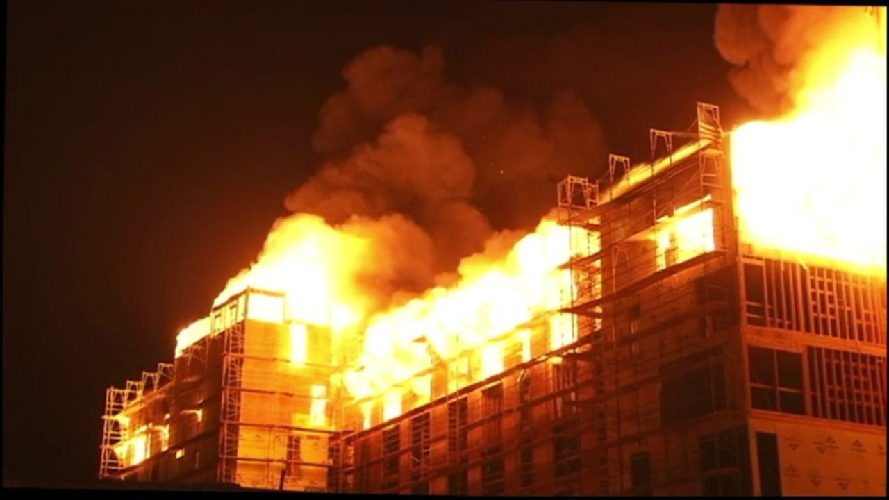 A 5-alarm fire burned at an apartment building that was under construction in Emeryville, Calif. near the Oakland border on Wednesday, July 6, 2016.