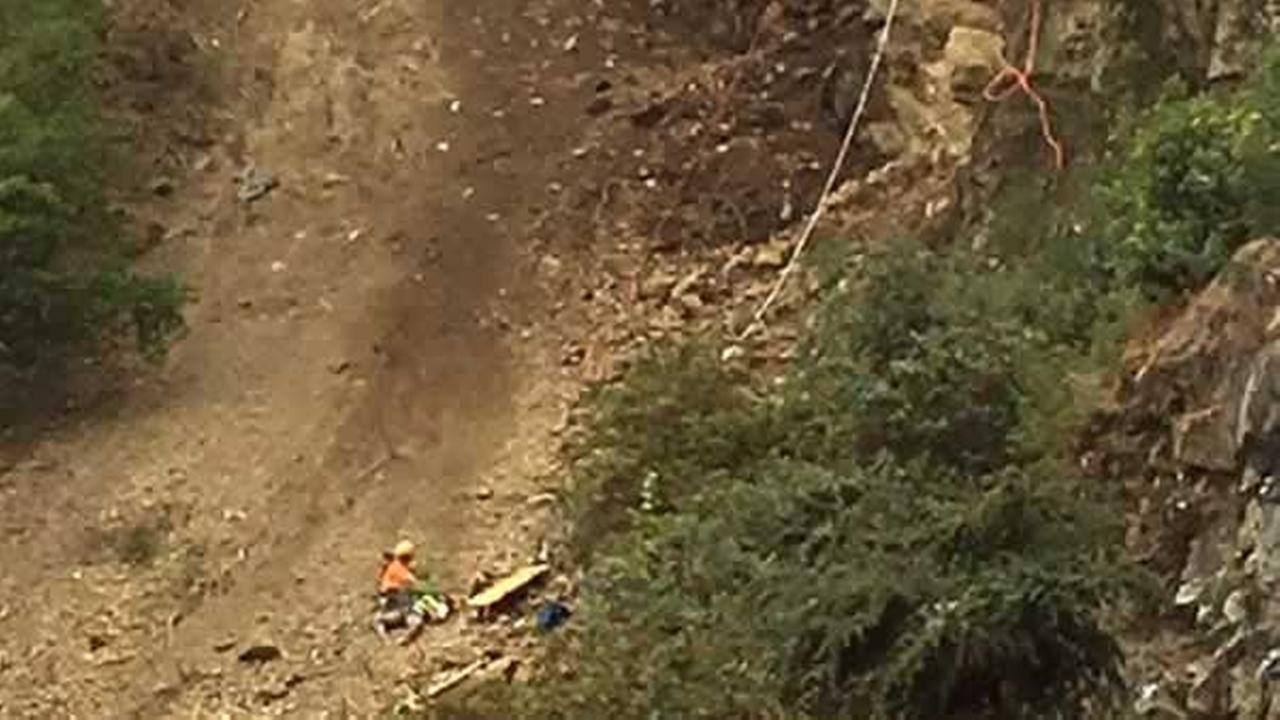 San Francisco fire crews work to rescue a construction worker who fell 50 feet down a cliff in San Francisco, Calif. on Thursday, July 7 , 2016.