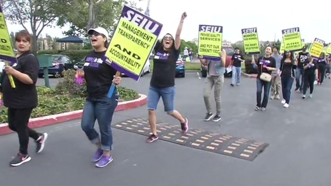 Child care case workers  walk the picket line outside the Community Child Care Council of Santa Clara County on Thursday, July 7, 2016 in San Jose, Calif.
