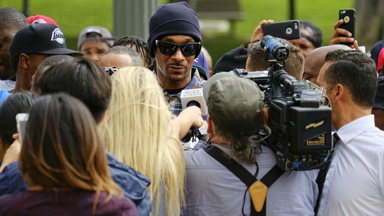 Rapper Snoop Dogg is surrounded by media during a march in support of unification outside of an LAPD graduation ceremony in Los Angeles, Friday, July 8, 2016. (AP Photo/Richard Vogel)AP Photo/Richard Vogel