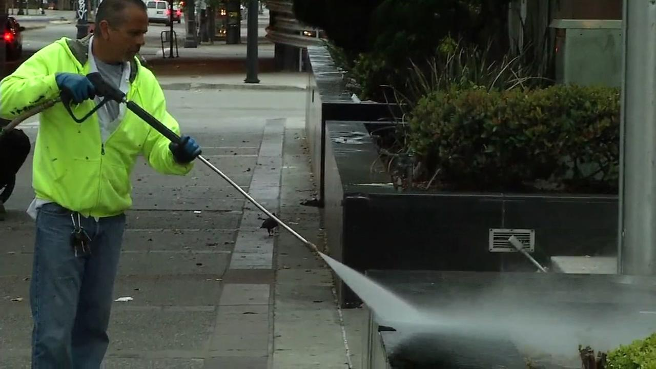 Crews clean up in Oakland, Calif. on Friday, July 8, 2016 following an anti-police protest the night before.KGO-TV