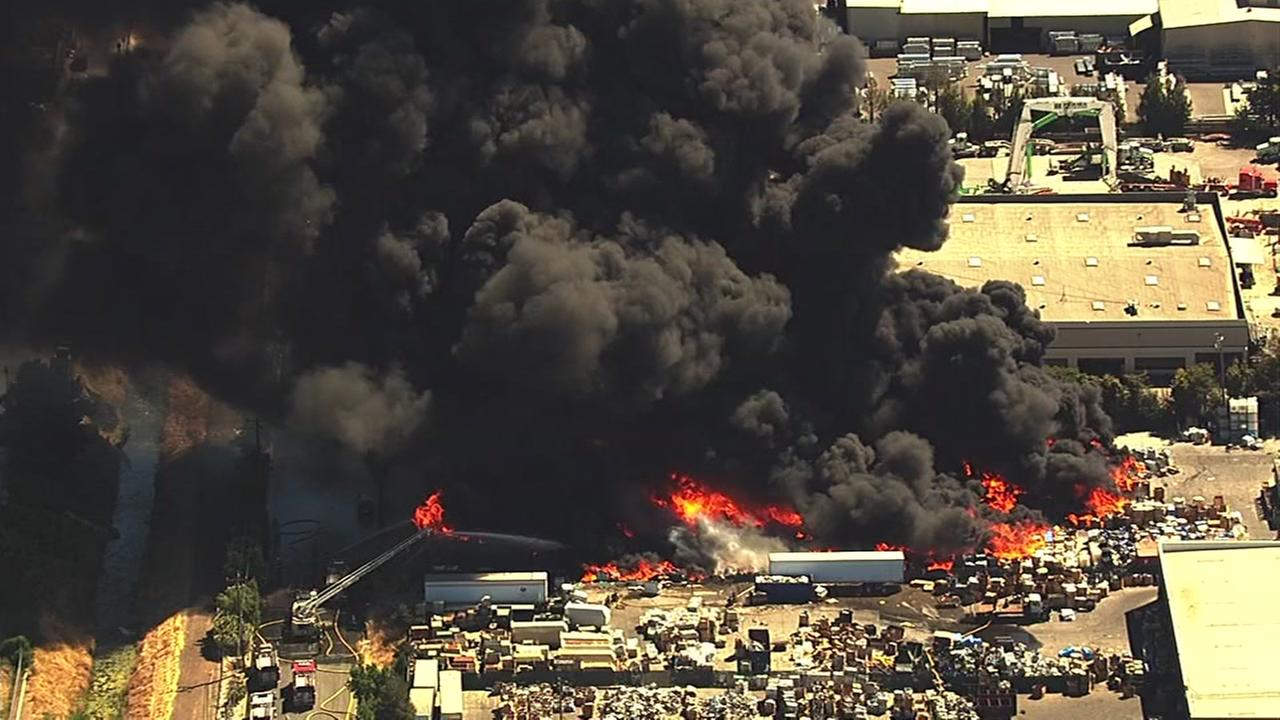A massive fire burns at a recycling center in Newark, Calif., on Friday, June 8, 2016.