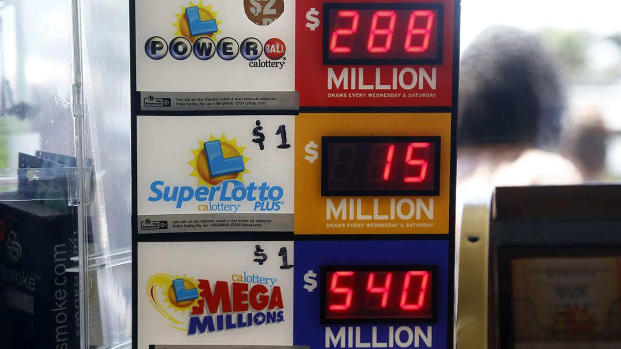 An electronic sign at Bluebird Liquors in Hawthorne, Calif., displays lottery jackpots Friday, July 8, 2016. The Mega Millions jackpot for Fridays drawing has soared to over $500 million.
