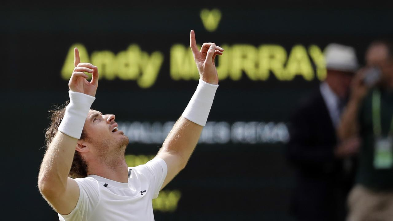 Andy Murray of Britain celebrates after beating Milos Raonic of Canada in the mens singles final on the fourteenth day of the Wimbledon Tennis Championships in London, Sunday, July 10, 2016.