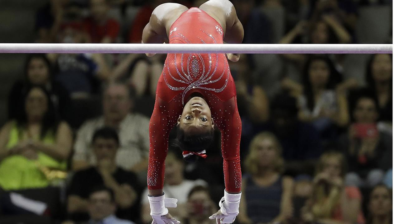 Simone Biles competes on the uneven bars during the womens U.S. Olympic gymnastics trials in San Jose, Calif., Sunday, July 10, 2016. (AP Photo/Gregory Bull)
