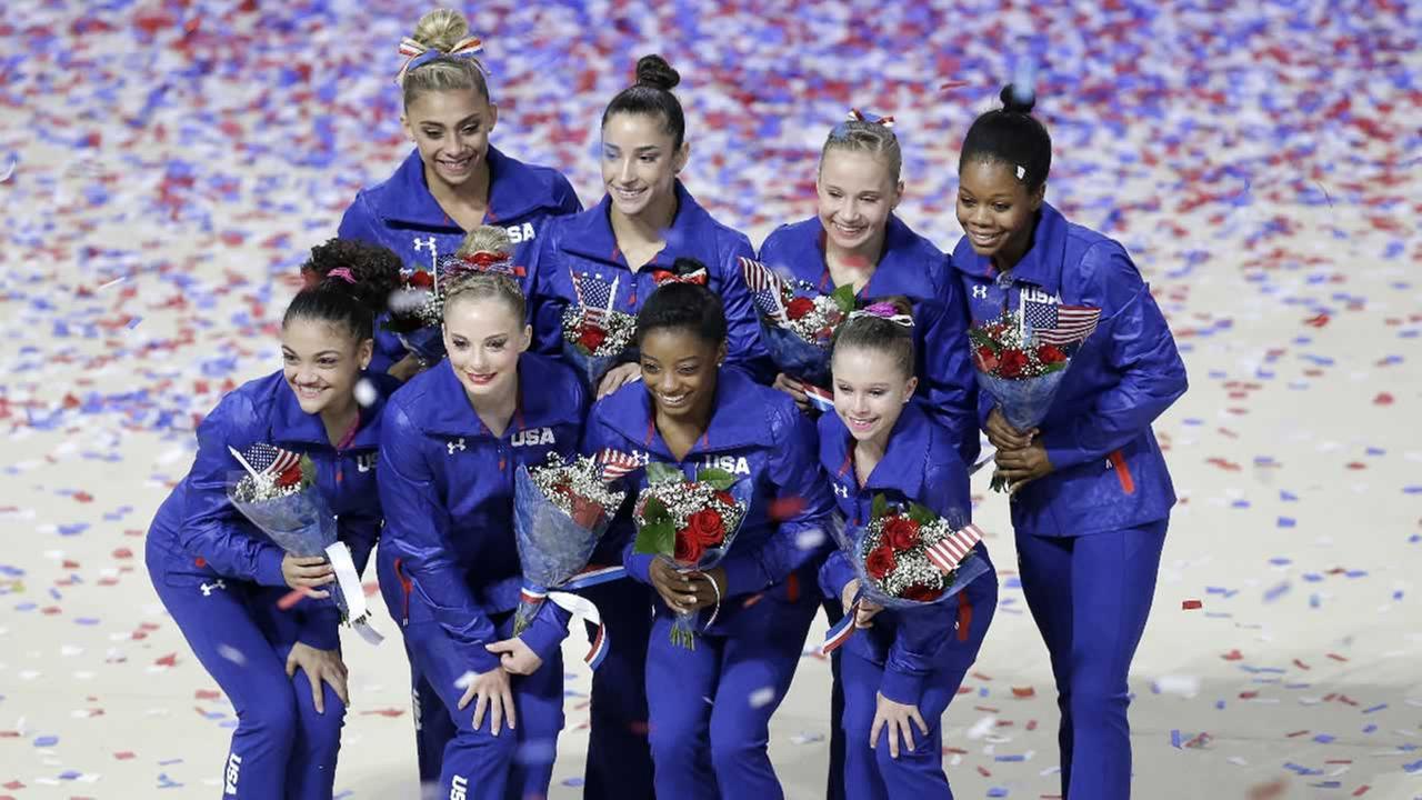 U.S. womens gymnastics team:  Ashton Locklear, clockwise: Aly Raisman, Madison Kocian, Gabrielle Douglas, Ragan Smith, Simone Biles, MyKayla Skinner, and Lauren Hernandez.