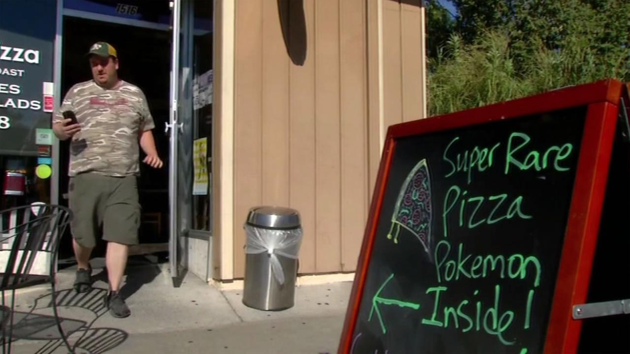 A pizza shop in Walnut Creek, Calif. uses a sign to draw in Pokemon Go gamers on Wednesday, July 13, 2016.