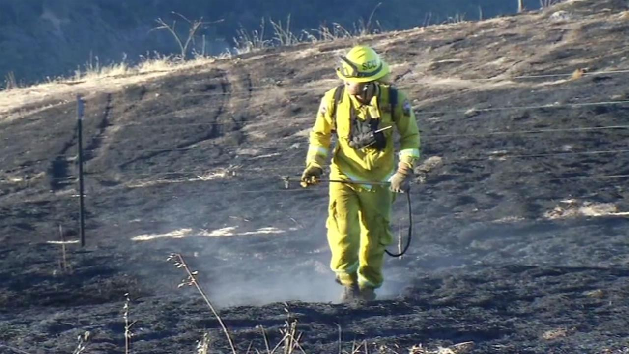 Firefighters knocked down a 10-acre grass fire on Thursday, July 14, 2016 in San Jose, Calif.