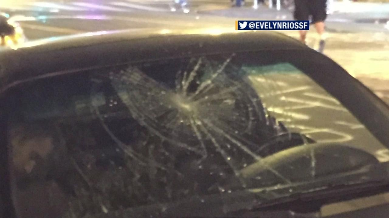 This image shows a car window that was broken in San Francisco after a protest got out of hand on July 15, 2016.