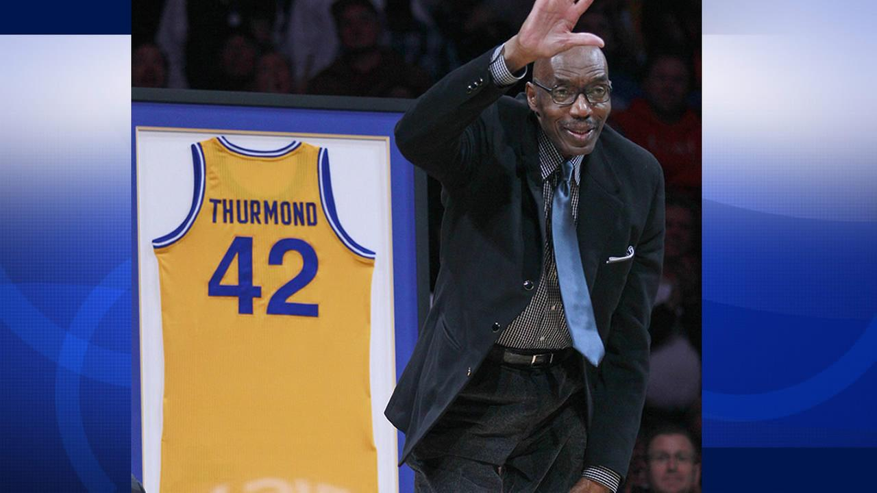 FILE - In this March 19, 2012, file photo, former Golden State Warriors player Nate Thurmond waves during a halftime ceremony in Oakland, Calif.