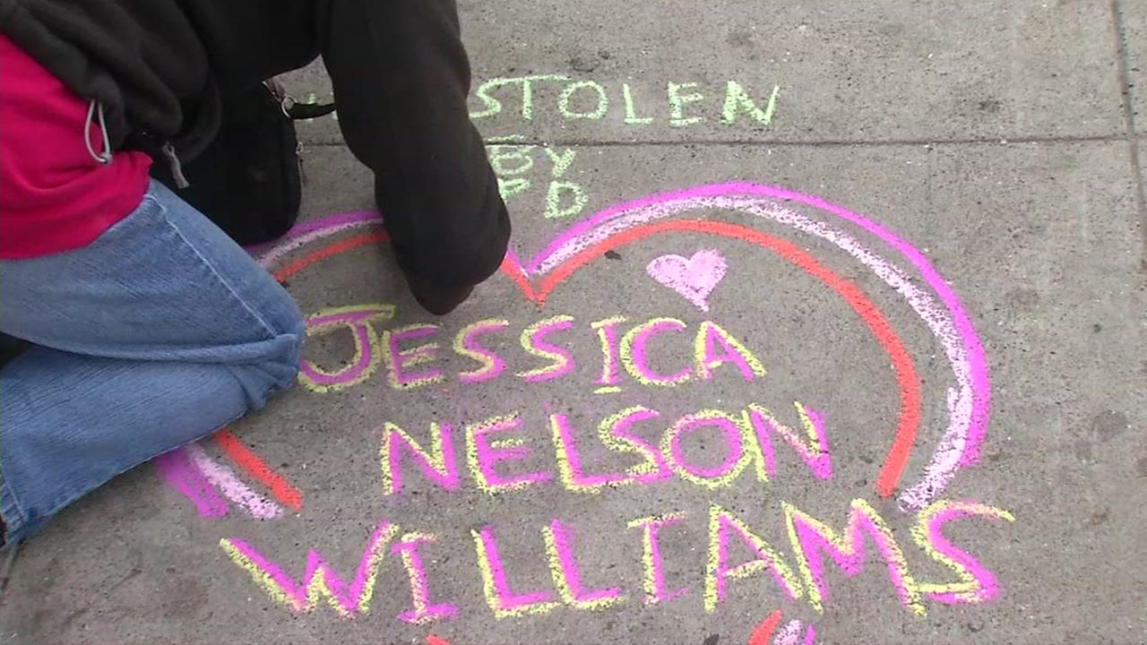 Someone writes the name Jessica Nelson Williams on a sidewalk in San Francisco, Calif. on Sunday, July 17, 2016.