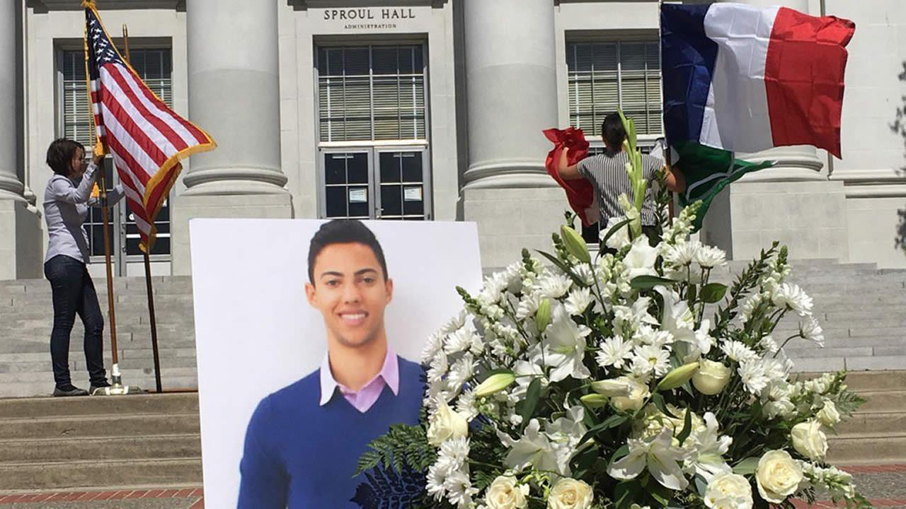 American and French flags are hung near a photo of 20-year-old Nick Leslie in Berkeley, Calif. on July 18, 2016. The Cal student was killed in the deadly attack in Nice, France.