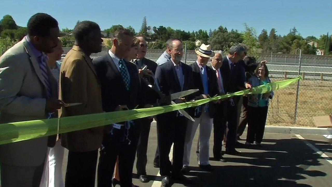 Officials celebrate the completion of the Highway 4 widening project in Antioch, California, Wednesday, July 20, 2016.