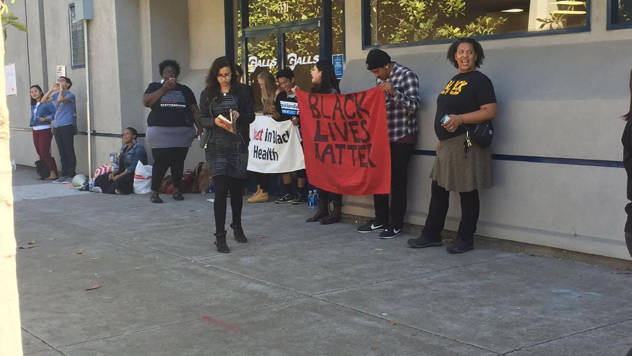 This image shows protesters in Oakland chaining themselves to the Oakland Police Officers Association in Oakland, Calif. on July 20, 2016.KGO-TV