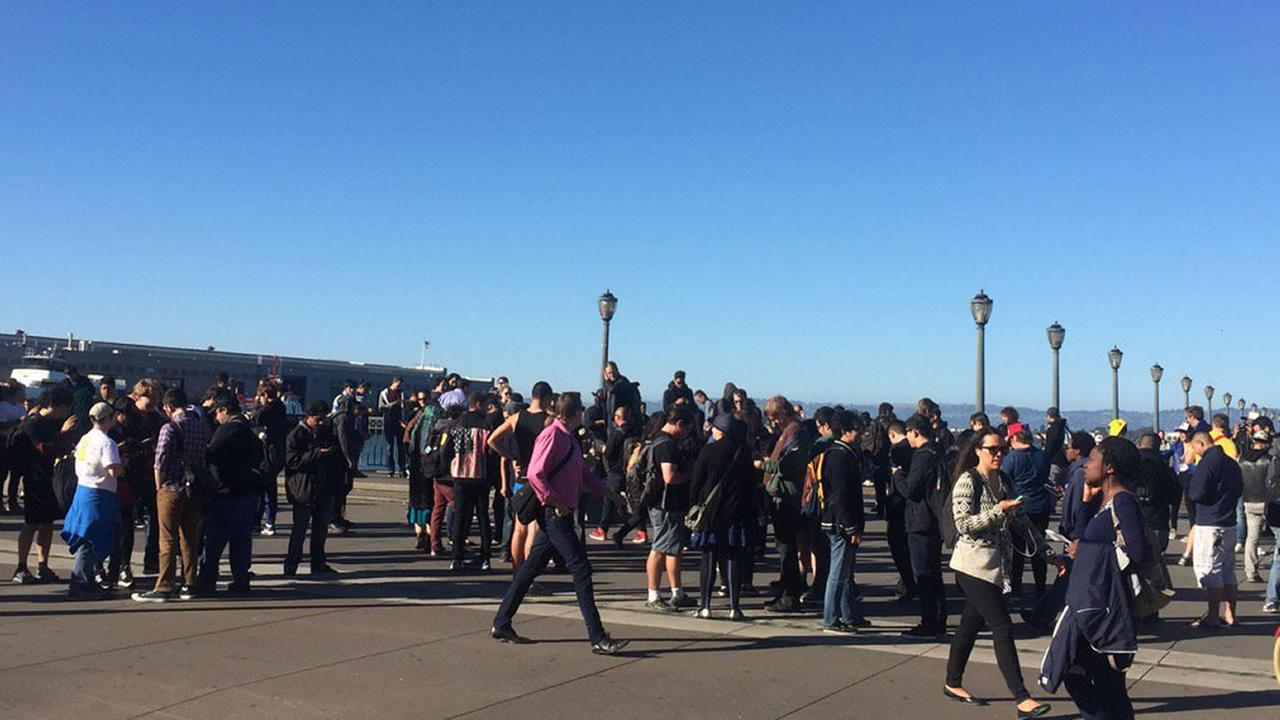 Pokemon Go players walk along the Embarcadero in San Francisco ahead of an event on Wednesday, July 20, 2016.Melanie Woodrow/KGO-TV