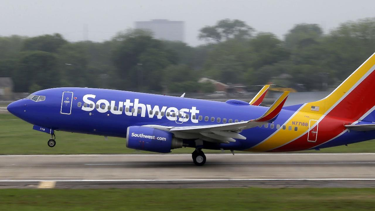 In this April 23, 2015, file photo, a Southwest Airlines jet takes off from a runway at Love Field in Dallas.