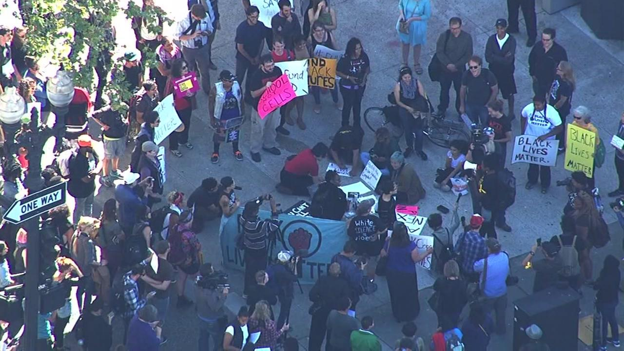Black Lives Matter protesters demonstrate outside police headquarters in Oakland, Calif. on Thursday, July 21, 2016.KGO-TV