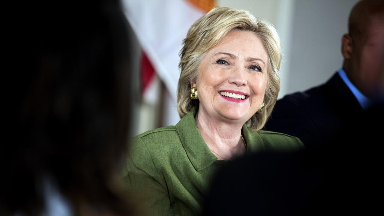 Democratic presidential candidate Hillary Clinton smiles while attending a roundtable with Orlando Mayor Buddy Dyer and community leaders at the Holden Heights Community Center in Orlando, Friday, July 22, 2016 about the attack on the Pulse nightclub.