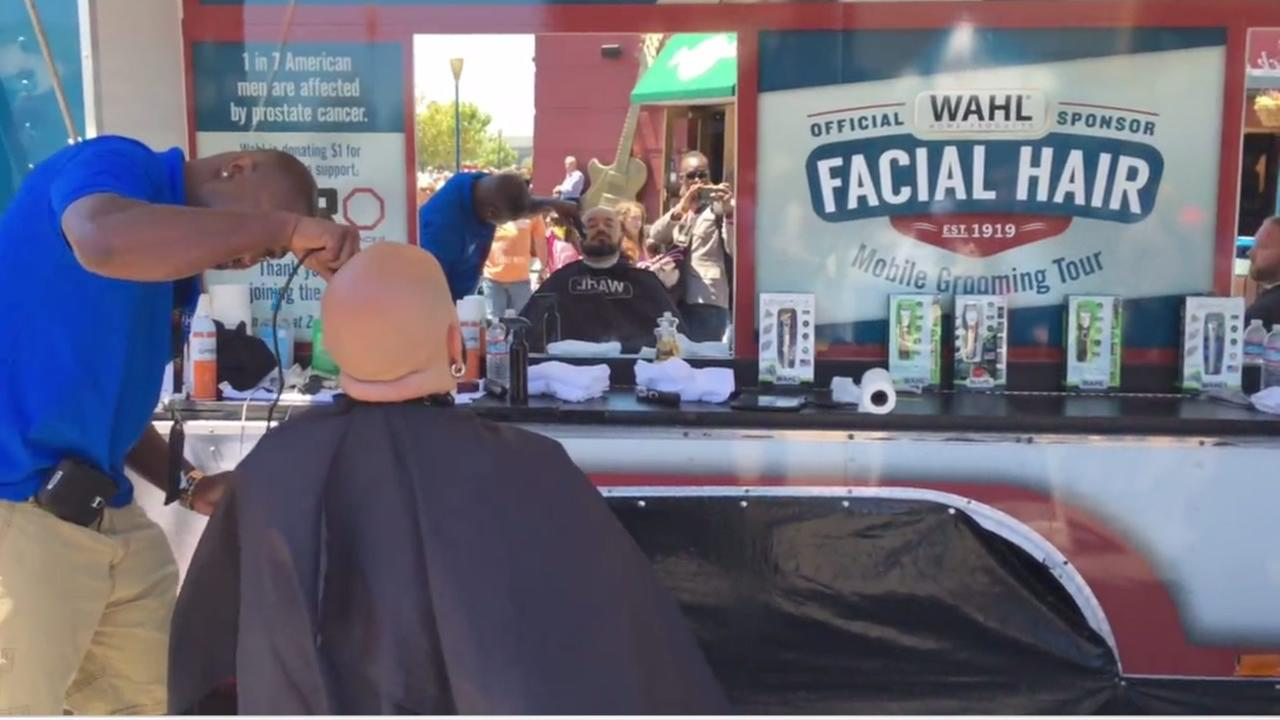 Master barbers with Wahl gave free trims for a cause at their mobile barbershop set up at Pier 39 in San Francisco on Friday, July 22, 2016.