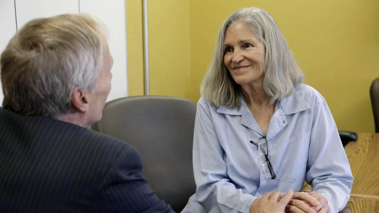 Former Charles Manson follower Leslie Van Houten confers with her attorney Rich Pfeiffer at the California Institution for Women in Chino, Calif., Thursday, April 14, 2016.