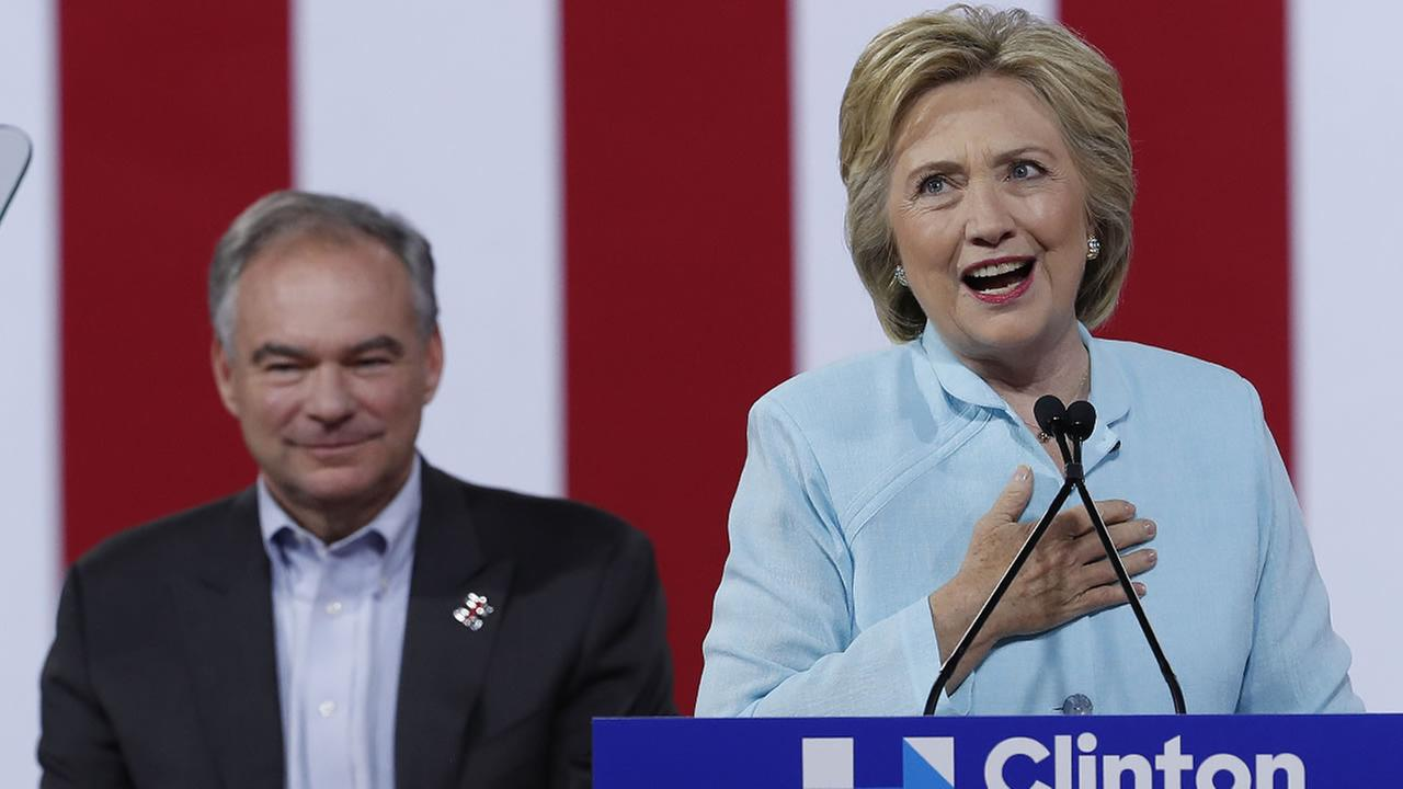 Democratic presidential candidate Hillary Clinton is joined by Sen. Tim Kaine, D-Va., as she speaks during a campaign rally in Miami, Saturday, July 23, 2016.