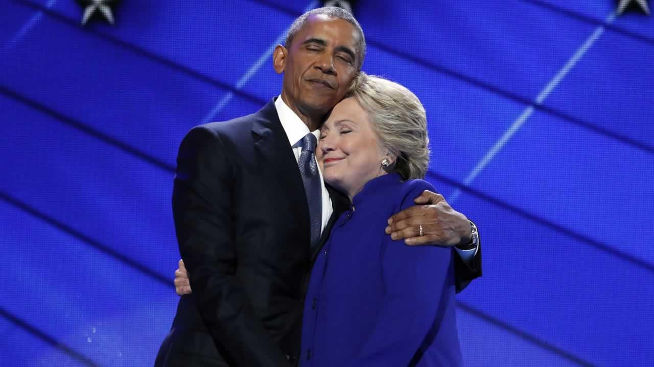 Barack Obama hugs Dem. Presidential candidate Hillary Clinton after addressing the delegates at the Democratic National Convention in Philadelphia, Wednesday, July 27, 2016.