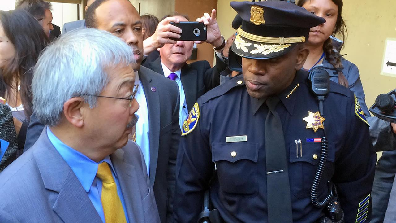 San Francisco Mayor Ed Lee, left, walks with new acting San Francisco Police Chief Toney Chaplin on Friday, May 20, 2016. (AP Photo/Paul Elias)