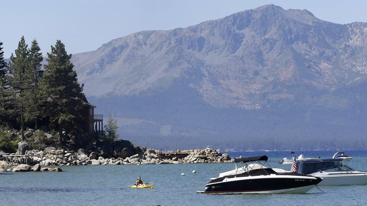 In this Aug. 24, 2015 file photo, a kayaker paddles along Zephyr Cove, the sight of the 19th Annual Lake Tahoe Summit in south Lake Tahoe, Nev. (AP Photo/Rich Pedroncelli, File)