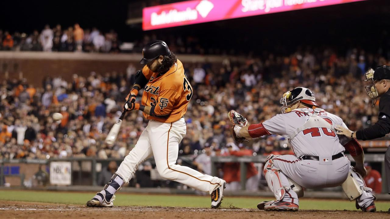 San Francisco Giants Brandon Crawford lines out into an inning-ending triple play during the eighth inning of a baseball game against the Washington Nationals July 29, 2016.