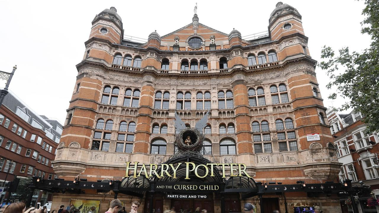 In this photo taken on Thursday, July 28, 2016, the Palace Theatre in London shows advertising for the new Harry Potter play.