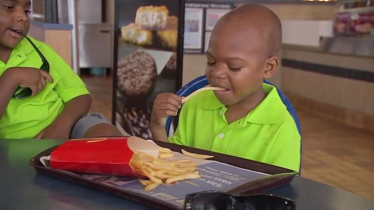 This undated image shows 6-year-old E.J. Paterson with his family at North Carolina fast food restaurant.