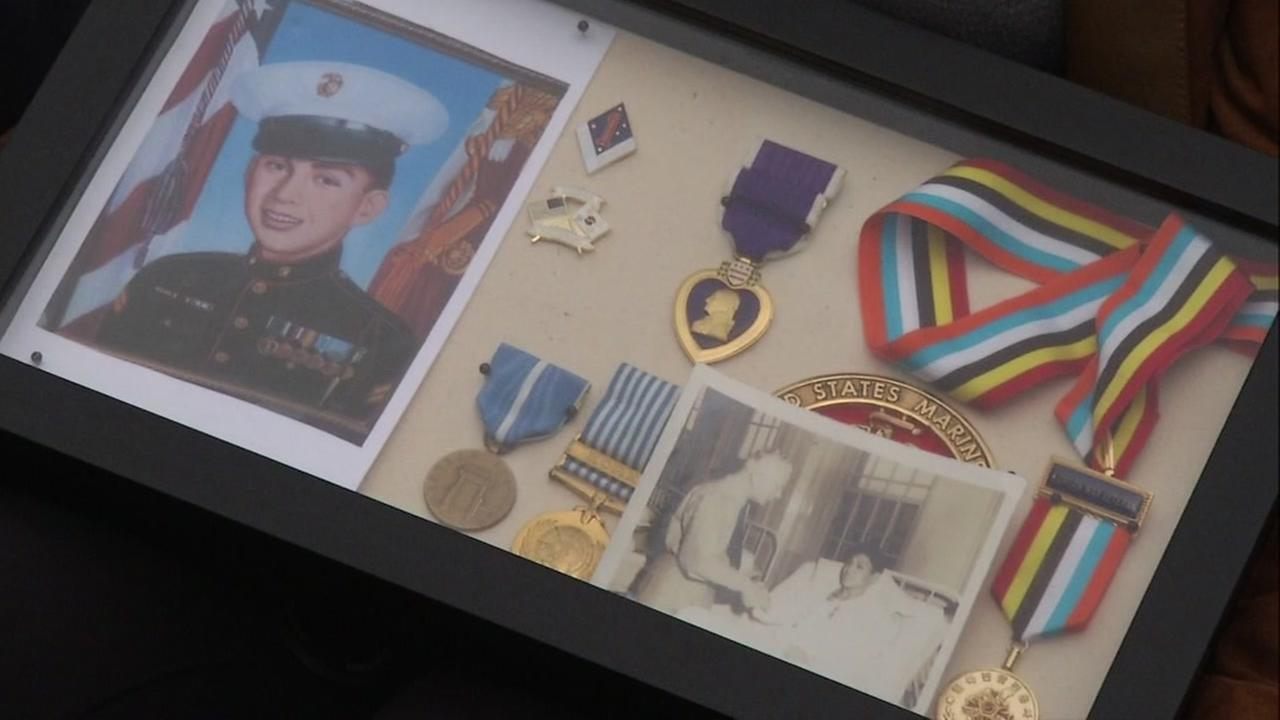 Lisa Ginn carried memories of her father in a box to the the Korean War Memorial that was unveiled in San Franciscos Presidio National Cemetery on Monday, August 1, 2016.KGO-TV