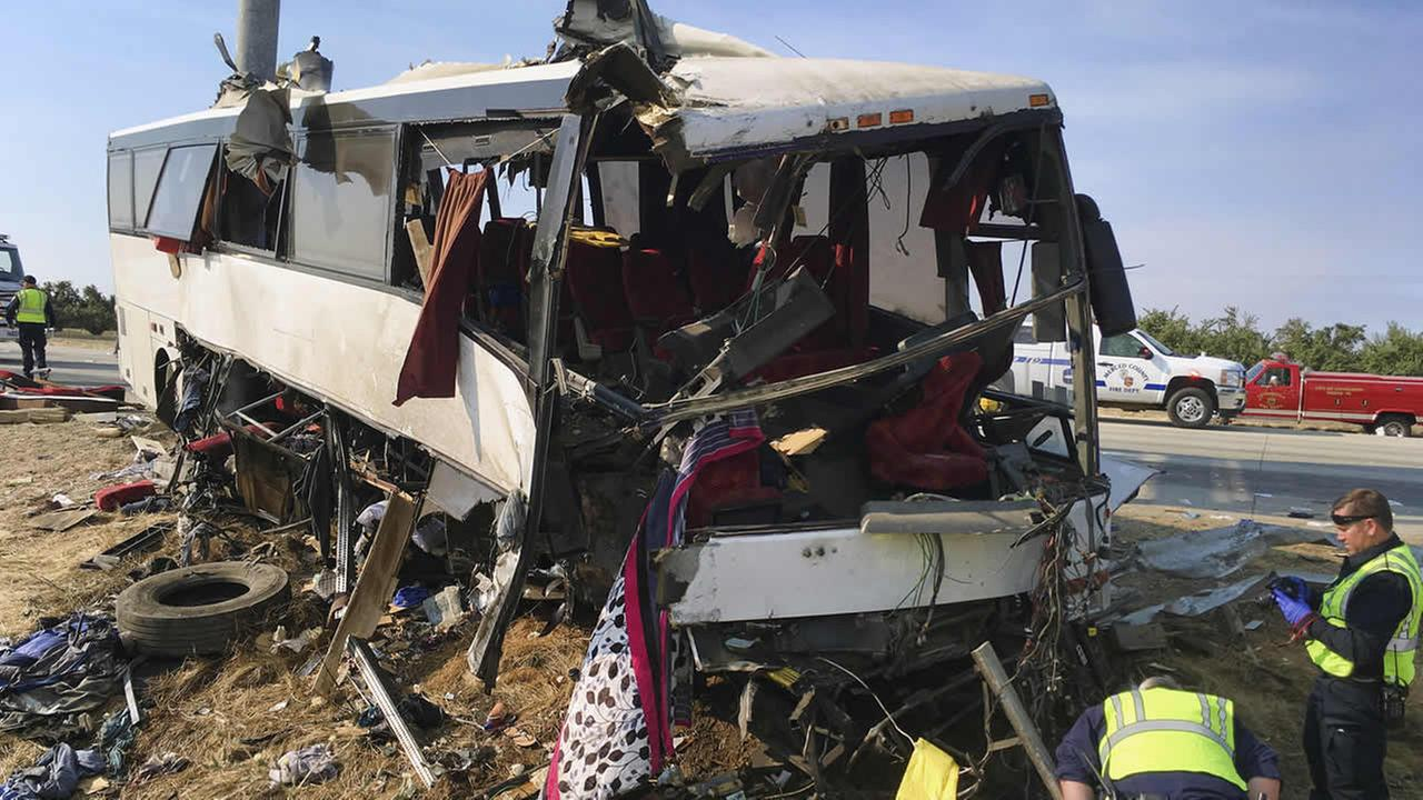 Authorities investigate the scene of a charter bus crash on northbound Highway 99 between Atwater and Livingston, Calif., Tuesday, Aug. 2, 2016. (AP Photo/Scott Smith)
